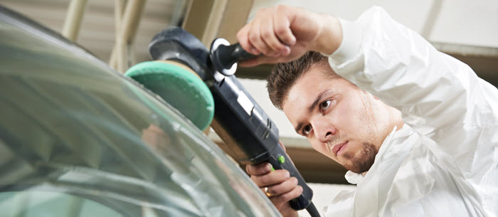 bigstock-auto-mechanic-worker-polishing-33017039